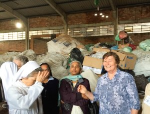 Sisters visiting a recycling project begun by the Passo Fundo province to assist local women in earning money for their families by recycling castoffs.